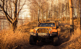 Leningrad oblast , Kirovsky district, Russia , December 25, 2015 , Jeep Wrangler in the forest, the Jeep Wrangler is a compact fou Royalty Free Stock Photos