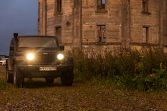 Leningrad region, Russia , August 14, 2016 , Jeep Wrangler abandoned water tower Inca in the Leningrad region, the Jeep Wrangler i Royalty Free Stock Images