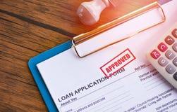 Leningsgoedkeuring/financieel leningsaanvraagformulier voor geldschieter en lener voor het landgoed van de hulpInvesteringsbank stock afbeelding