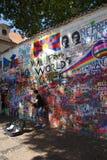 Lennon Wall, symbol of Prague resistance. PRAGUE - AUG 31, 2016 - Lennon Wall, symbol of Prague resistance to communism, overlaid graffiti, Prague, Czech Stock Image