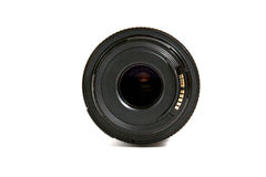 Lens. Black lens with cover isolated on white background Stock Photo