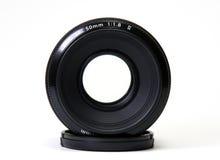 Lens. Black lens on a white background stock photo