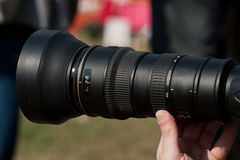 Lens. A man holding a zoom lens Stock Photo