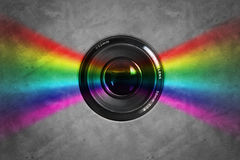 Lens. Colors bursting from camera lens Stock Image