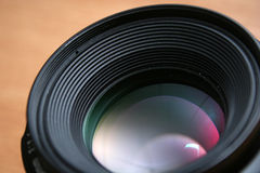 Lens. Front of a photographic lens with brown background stock image
