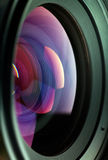 Lens. With refracted light and rainbow colors caused by refraction and the  coating.  Shallow DOF Royalty Free Stock Images