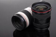 Lens. Two lens on black background Stock Photos