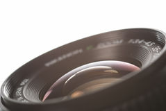 Lens. A lens with light reflections, on white Royalty Free Stock Images