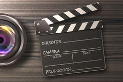 Movie clapper board open cinematography concept. Lens camera with movie clapper on wooden table stock photo
