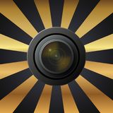 Lens camera, pattern of gray gold flowers in the background. Lens camera on a gold background, raster picture of logo camera Stock Photos