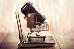 Lens camera shopping,lens and credit card in a shopping basket Stock Photos