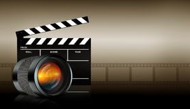 Lens and clap board on dark background. Photographic lens and clap board on dark background Royalty Free Stock Photography