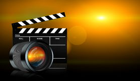 Lens and clap board on dark background Royalty Free Stock Images