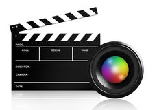 Lens & clap board on white. Lens & clap board isolated on white Royalty Free Stock Photography