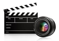 Lens & clap board on white. Lens & clap board isolated on white Royalty Free Stock Images