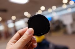 A lens cover or lens cap hold by hand stock image