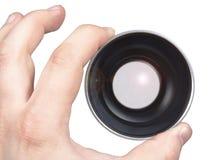 Lens in een hand Stock Foto