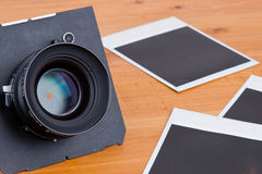 Lens and empty pictures Royalty Free Stock Photography