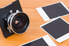 Lens and empty pictures Stock Photography