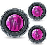 Lens and family. Reflection in glass Stock Photography