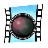 Lens and film frame Royalty Free Stock Photography
