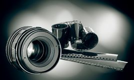 Lens & film strip Royalty Free Stock Images