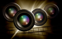 Lens & film strip on abstract dark background Royalty Free Stock Image