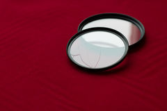 Lens filter with a broken glass. camera lens Stock Image