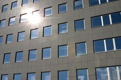 Lens flare. Sun reflection on front side of new building Stock Image
