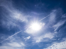 Lens flare on blue sky Royalty Free Stock Images