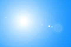 Lens flare in blue sky Stock Photography