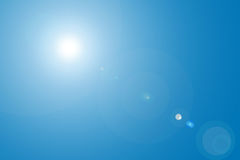 Lens flare in blue sky Stock Image