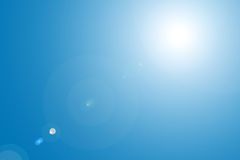 Lens flare in blue sky Stock Photos