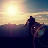 Lens flare. Hiker takes selfie photo. Tourist at peak Royalty Free Stock Photo