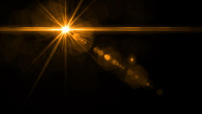 Lens Flare light over Black Background. Easy to add overlay. Or screen filter over photo Stock Photo