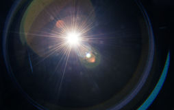 Lens flare. Natural lens flare on a dark background royalty free stock photography