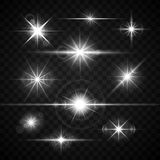 Lens flares glare lighting effects vector set. Shiny stars isolated on checkered background illustration Royalty Free Stock Image