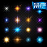 Lens glow effect. Big set of light effects on a dark background transparent. The effect of the lens, the sun glow, bright light. S. Et design for the Christmas Stock Images