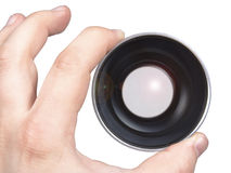 Lens in a hand Stock Photo