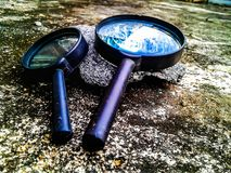Lens. Hand lens on the ground Royalty Free Stock Photography