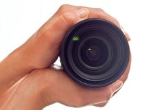 Lens in hands Stock Photography