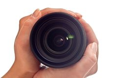 Lens in hands Stock Photos
