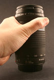 Lens hold by hand. A telephoto hold by hand Stock Image
