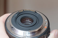 Lens. The lens mount from SLR camera in the hand Royalty Free Stock Photos