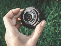Lens. In my hand I hold a camera lens Royalty Free Stock Image