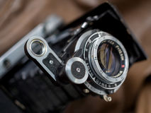 Lens of old bellows folding camera Stock Images