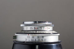 Lens of an old camera. On grey background Stock Image