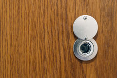 Lens peephole on new wooden texture front door Stock Images