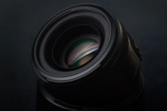 The lens of the photo on a dark background with a spot Royalty Free Stock Photos