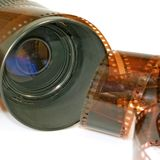 Lens and the photographic film Royalty Free Stock Photography